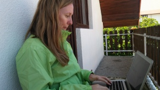 Claire writing on the go
