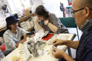 Aom at a studio visit with artists